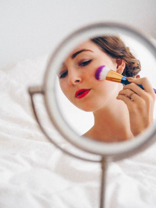 A new study has claimed that women who wear a lot of makeup are seen to be less intelligent (Credit: Unsplash)