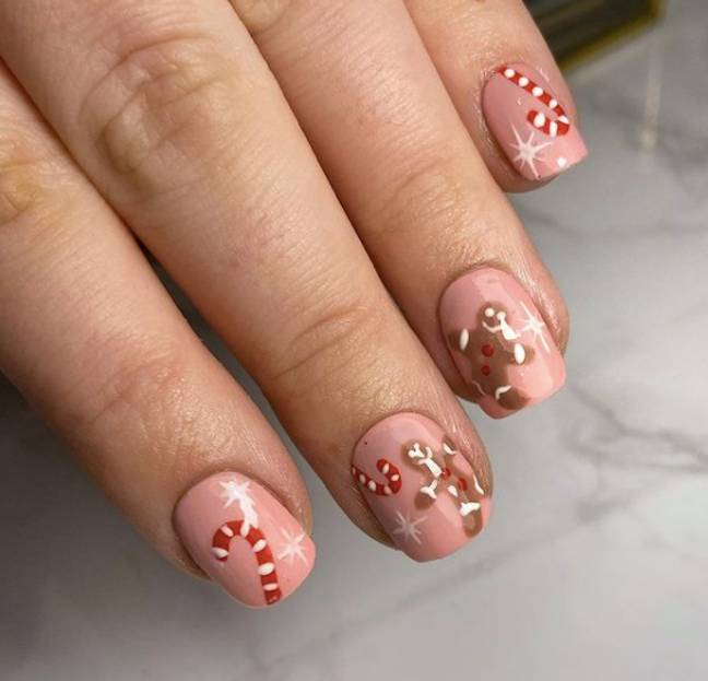 One Instagrammer added extra gingerbread men to her manicure (Credit: Instagram/@the_beauty_boss)