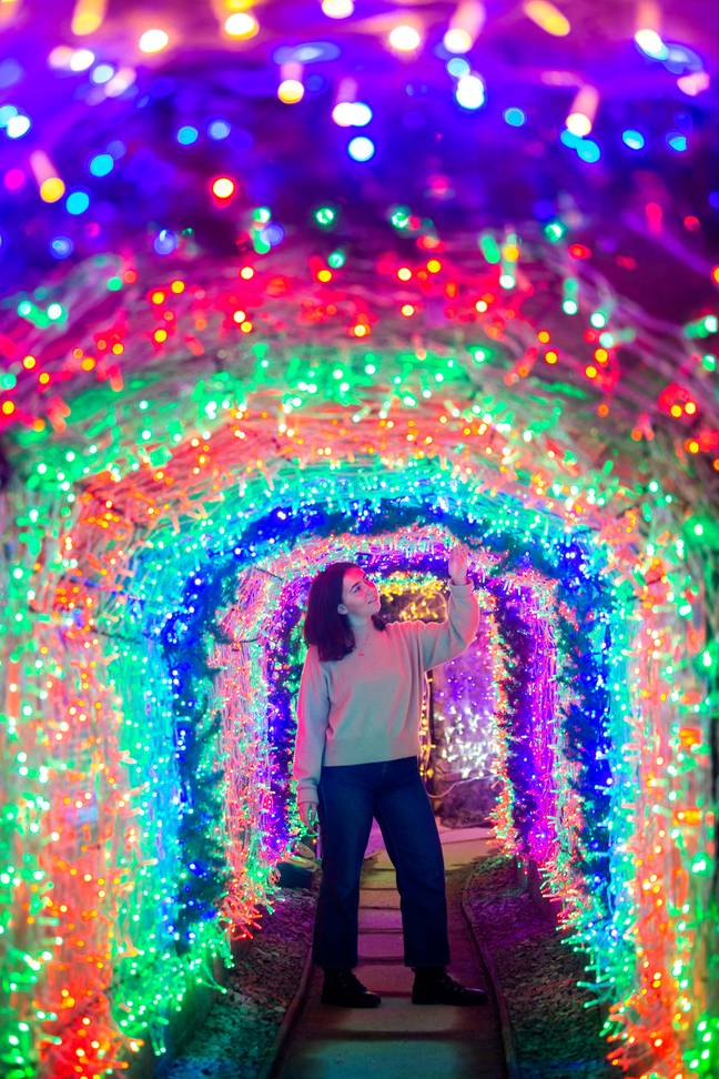 The 110-metre-long tunnel is brightly decorated with an astounding 40,000 multi-colour lights (Credit: SWNS)