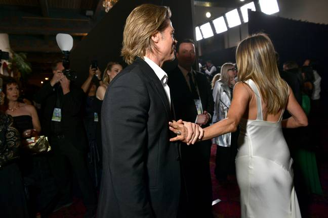 Brad could be seen holding Jen's arm as she walked away (Credit: Getty)
