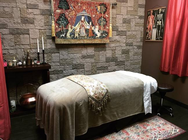 The setting features setting decked out with owl details, a 'Fat Lady' replica portrait, potion bottles and tapestries that are straight out of Hogwarts. (Credit: Wand & Willow Day Spa)