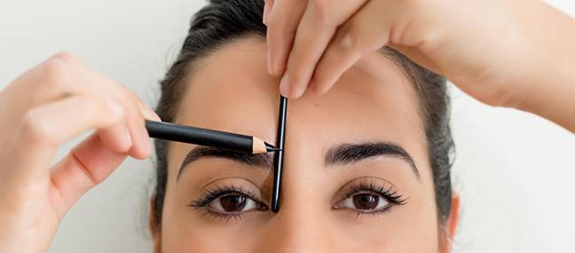 Use a sharp pencil and ruler to align the inner edges of your brows with the bridge of your nose to map out your desired shape (Credit: Suman Brows)