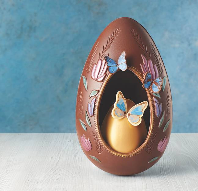 This egg is beautifully hand decorated with butterflies and has a second egg inside (Credit: ALDI)