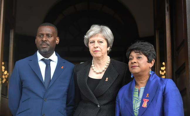 Theresa May with both of Stephen Lawrence's parents in 2018 (Credit: PA Images)