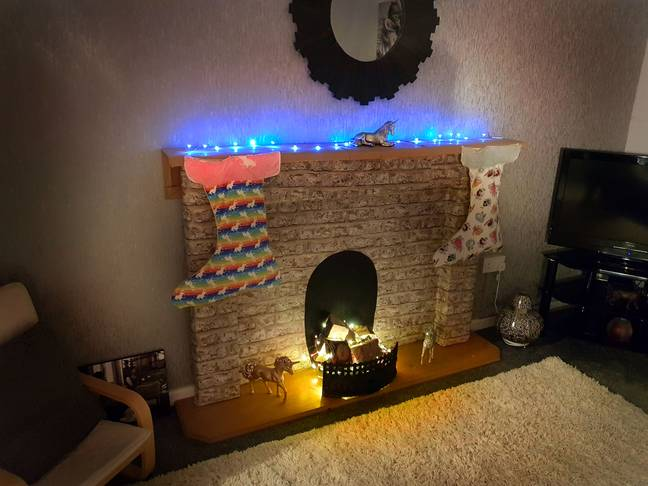 A Chester mum has built her own fireplace for £2. (Credit: Caters)