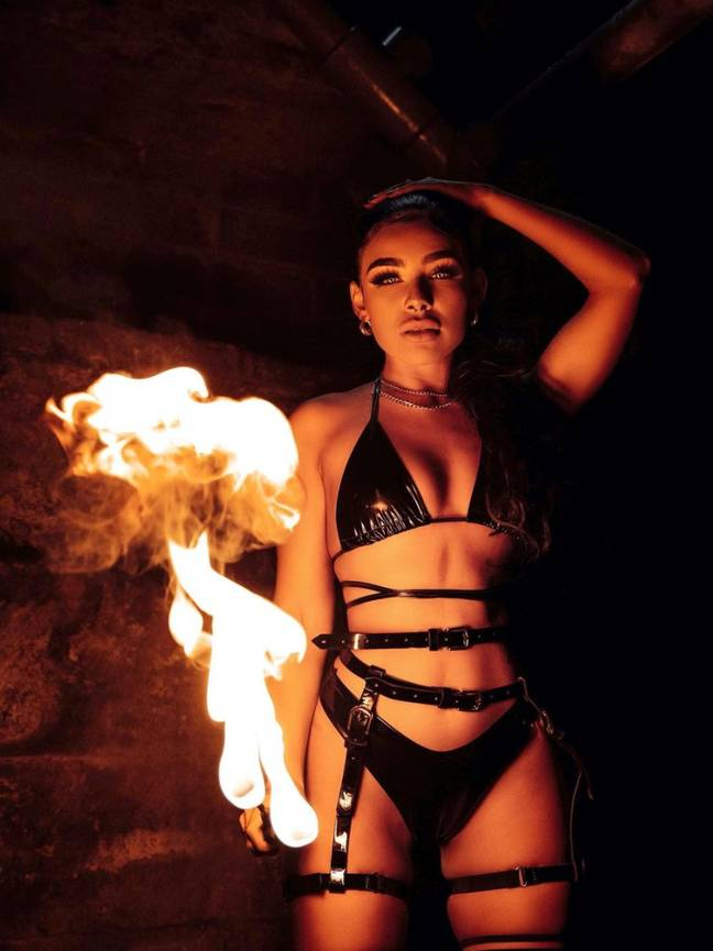Alexis Bailey is a professional fire-eater and aerial dancer (Credit: Instagram/alexis.baileyyx)