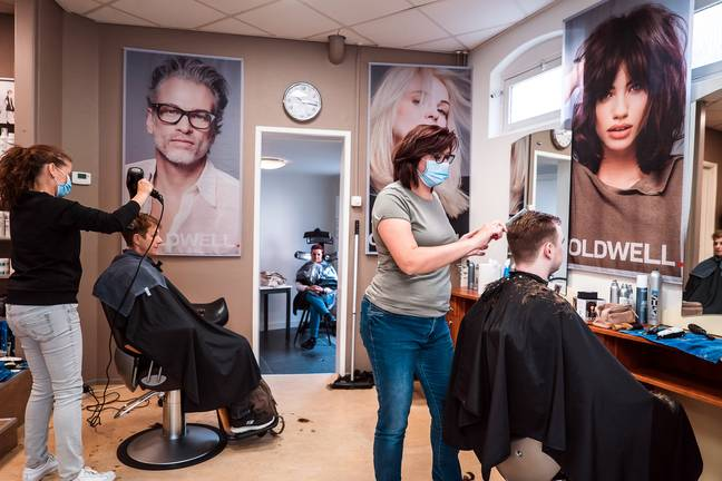 A salon in the Netherlands, where staff are required to wear face coverings but clients are mask-free (Credit: Unsplash)