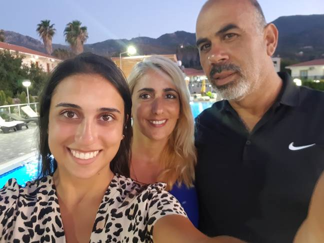 Cigdem pictured on holiday with her parents (Credit: Cigdem Tanrioglu)