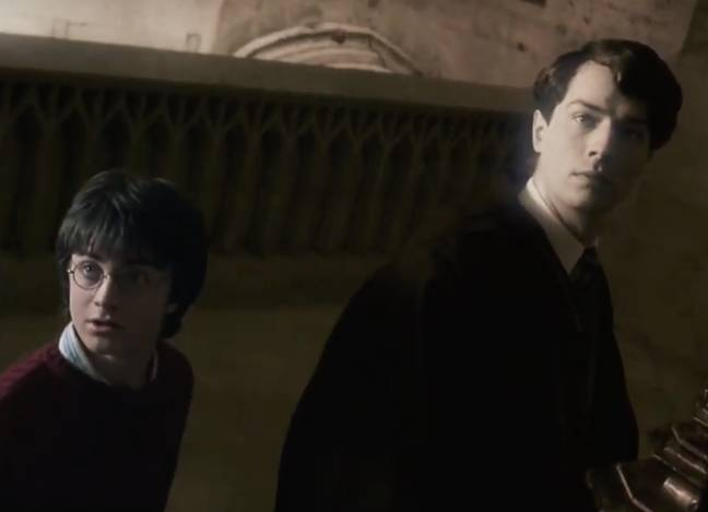 Tom Riddle shows Harry flashbacks of when he was at school. Credit: Warner Bros.