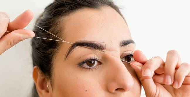 Do subtle, minimal tidying under the brows, above the eyelids and your brow tails. Don't overdo it! (Credit: Suman Brows)