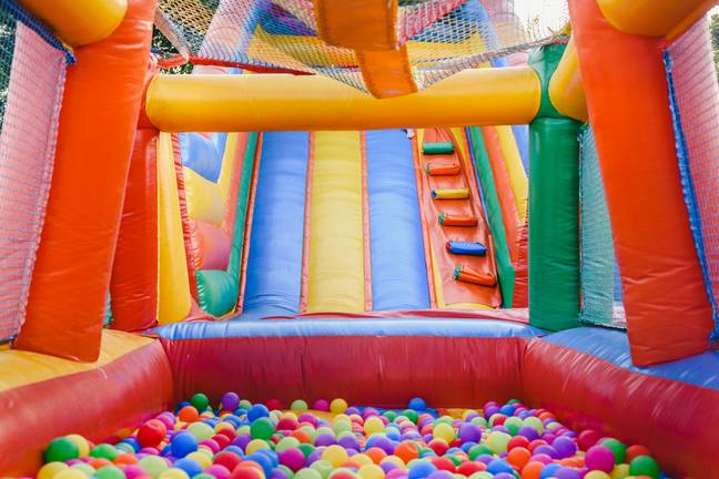 Who wouldn't want a bouncy castle in their back garden? (Credit: Shutterstock)