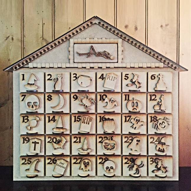 A wooden carved Halloween advent calendar is also available (Credit: Nearkissstudio/ Etsy)
