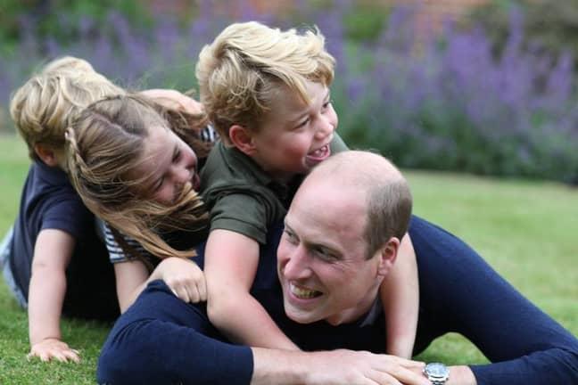 Prince George, Princess Charlotte and Prince Louis pile on top of royal dad Will (Credit: Kensington Royal / Instagram)