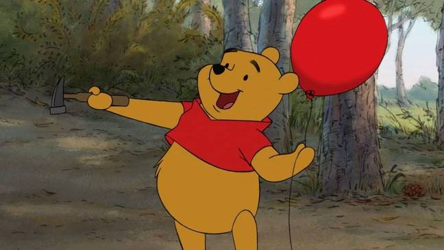 We'll likely see Winnie in his signature red jumper on the coin (Credit: Disney)