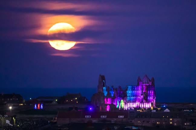 The Hunter's Moon has an orange glow Credit: PA