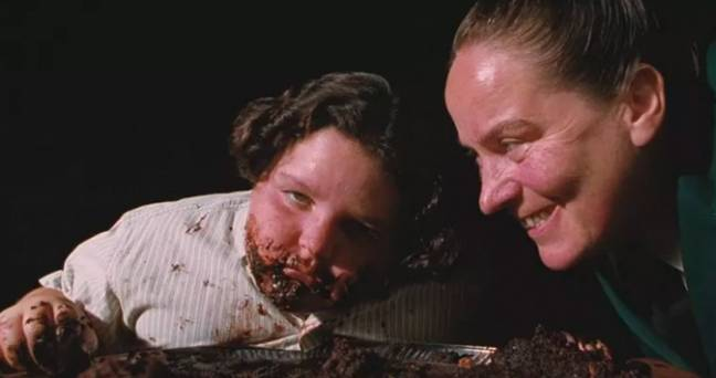 Bruce Bogtrotter is forced to eat a chocolate cake by Miss Trunchbull (Credit: Sony Pictures)