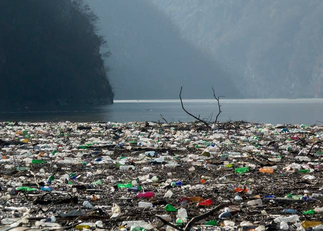 Plastic bottles, wooden planks, rusty barrels and other garbage clogging the Drina river near the eastern Bosnian town of Visegrad, Bosnia (Credit: PA)