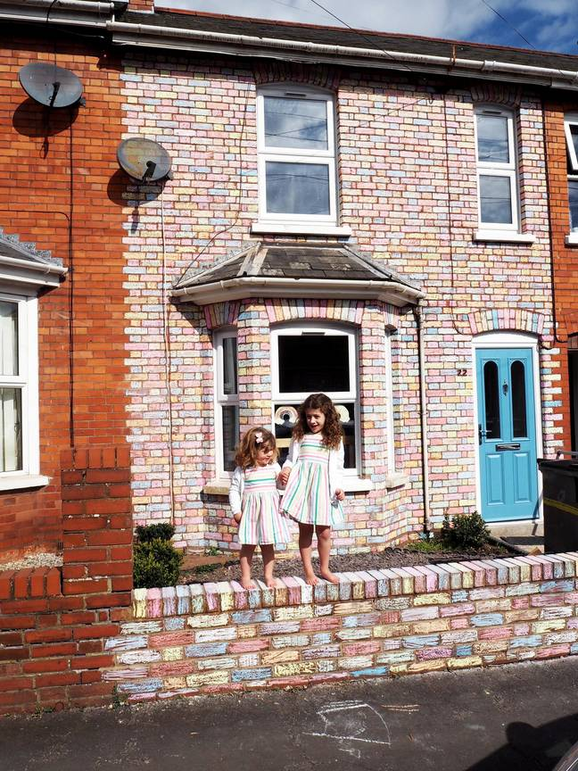 Arabella and Matilda spent hours colouring in the bricks (Credit: SWNS)