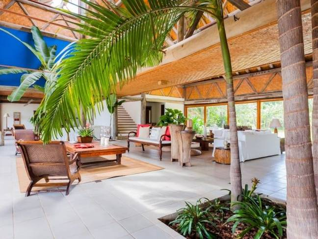 It features skylights, as well as palm and banana trees, eucalyptus posts and beams (Credit: Vrbo)