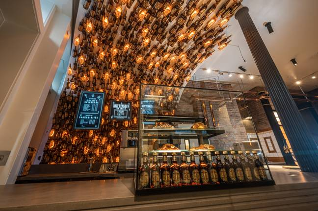 Fans will be met with 1,000 Butterbeer bottles rising from the floor and floating over the bar (Credit: Warner Bros.)