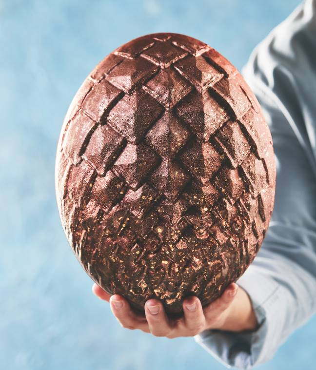 This milk chocolate dragon egg has been finished with metallic ombre (Credit: ALDI)