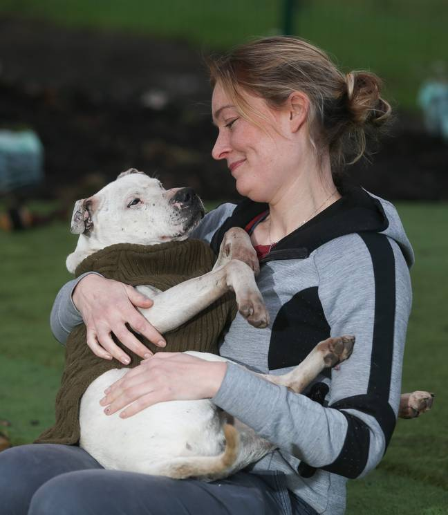 Zach loves cuddles with the staff at the sanctuary (Credit: Caters)