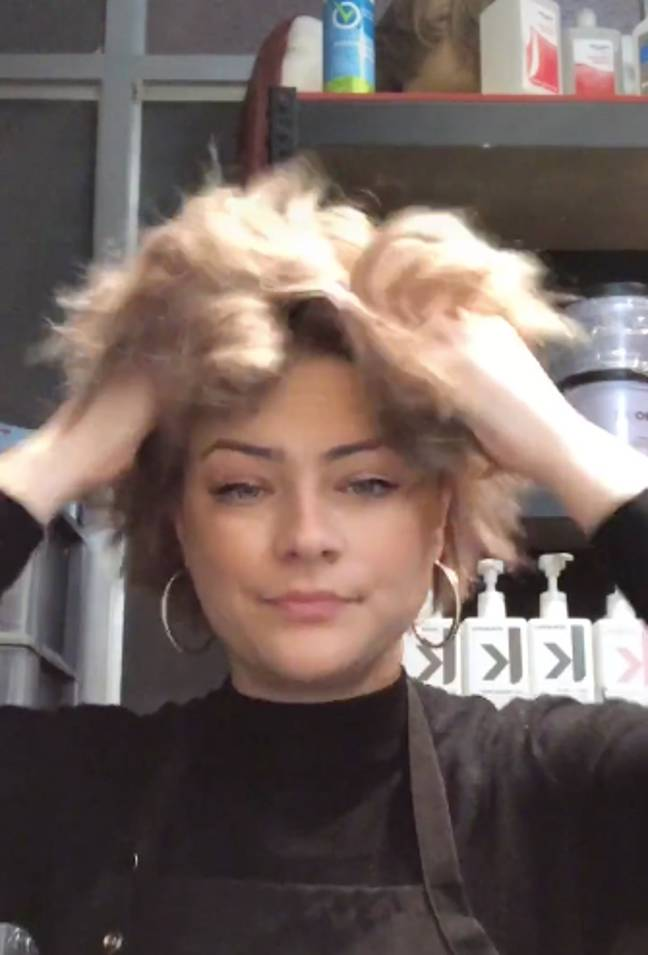 After leaving the product to sink in for 5-10 minutes, massage thoroughly into your hair and roots (Credit: TikTok / @corascamera)