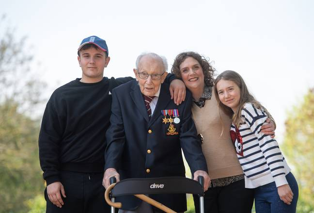 Captain Tom pictured with his family in Bedfordshire (Credit: PA)