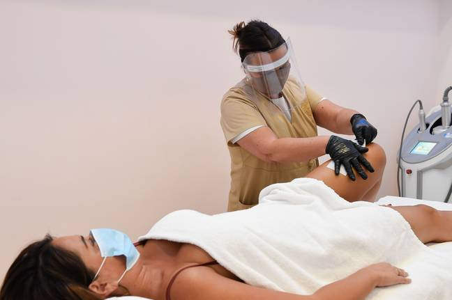 A sign of things to come? Over in Italy, beauty salons are already reopening with staff required to wear visors and customers wearing masks (Credit: Shutterstock)