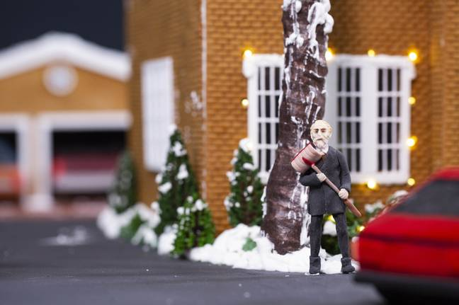 Tiny icing figures decorate the house (Credit: PA)