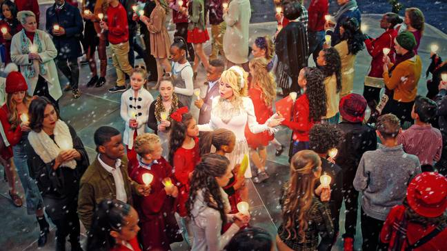 Dolly Parton stars as an angel in new Netflix movie 'Christmas on the Square' (Credit: Netflix)
