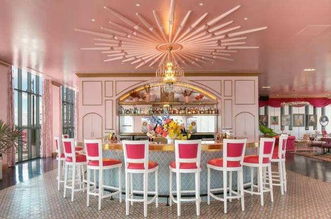 The new bar is a pink-themed homage to the iconic country singer (Credit: Graduate Nashville)