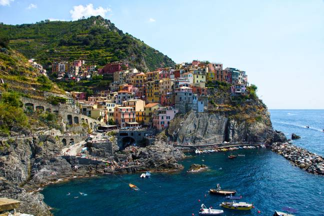 Many homes that overlook the town centre are in need of major works. Pictured Manarola (Credit: Unsplash)