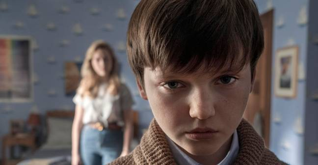 Benjamin Evan Ainsworth plays the orphaned nephew, Miles (Credit: Netflix)