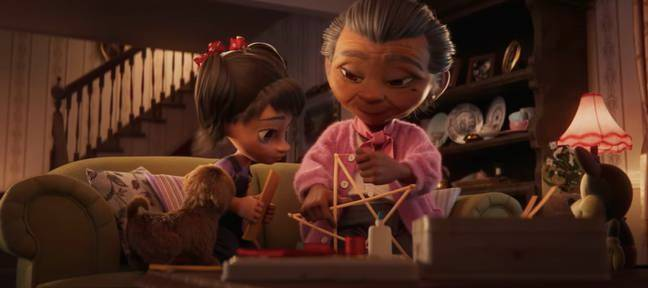 Lola and her granddaughter decorating for Christmas in the sweet video clip (Credit: Disney)