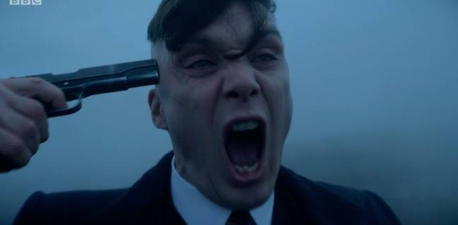 Tommy Shelby puts a gun to his head at the end of season 5 (Credit: BBC)