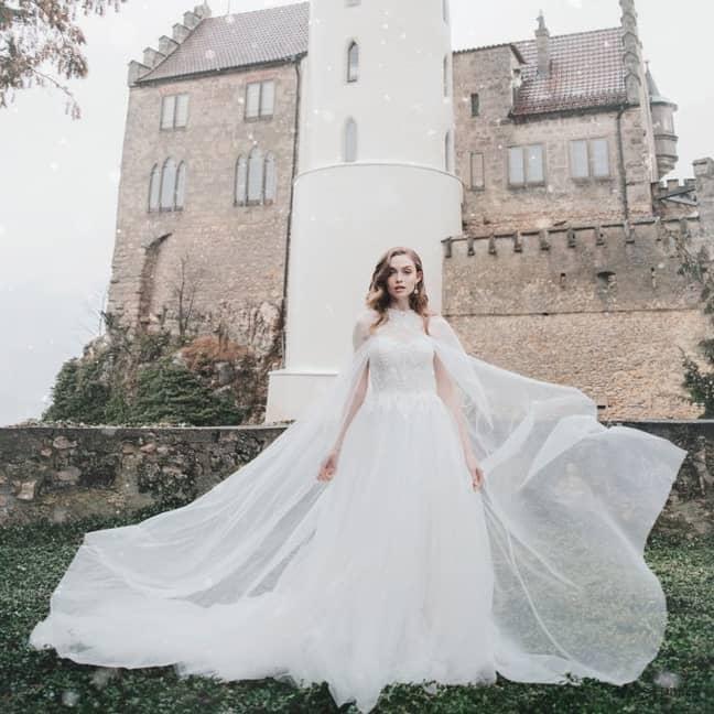 One of Princess Aurora's gowns features a diaphanous, lace detailed bridal cape (Credit: Allure Bridal/Disney)