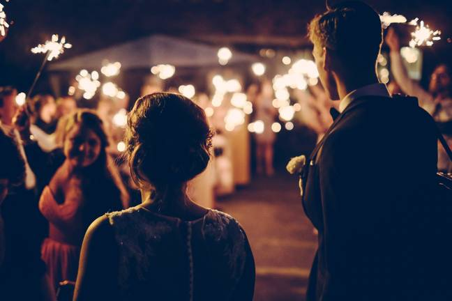 The bride explained how her mother-in-law brought her husband's ex as her plus one (Credit: Unsplash)