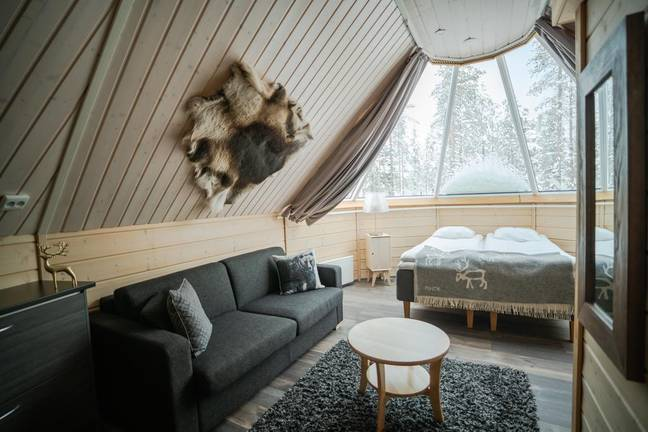 The cabins are cosy havens with plush soft furnishings and private bathrooms (Credit: Northern Lights Village)