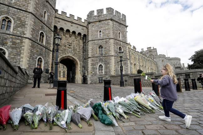 Flowers have been left by the public outside Windsor Castle in tribute to Prince Philip (Credit: PA)