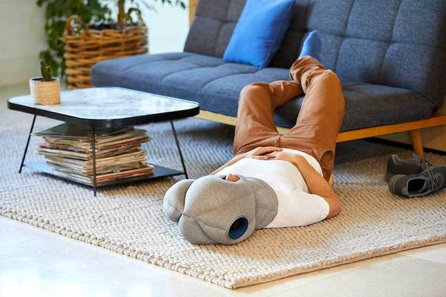 You could make like this guy, and nap on the floor of your office reception area - if you want to (Credit: Ostrich Pillow)