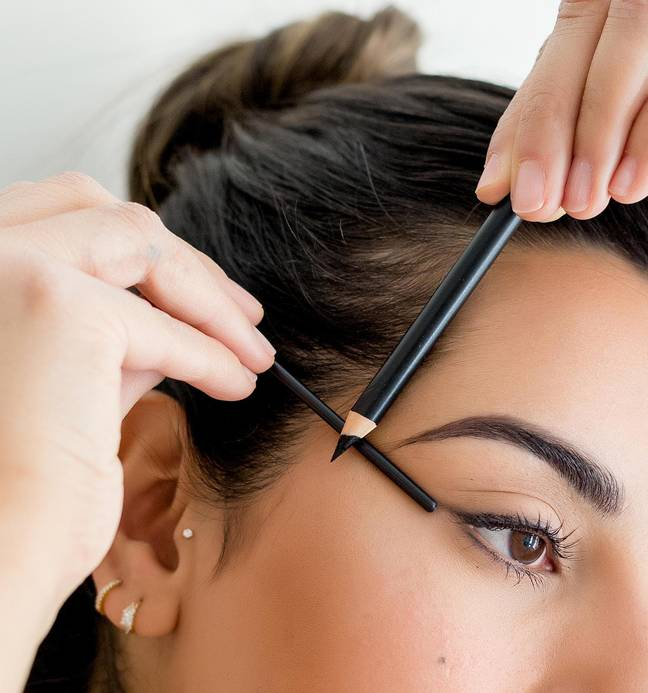 Use a ruler or brow pencil to draw your guide lines, aligning your brow tail with the outer corner of your eye (Credit: Suman Brows)