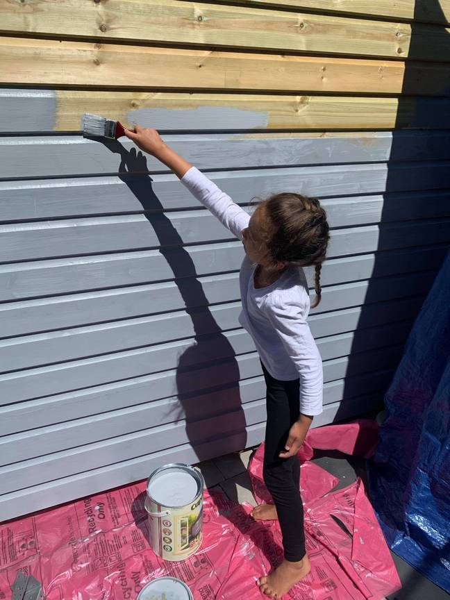 A lick of paint completes the exterior - even Andy and Jodie's daughter helped out! (Credit: Latestdeals.co.uk)