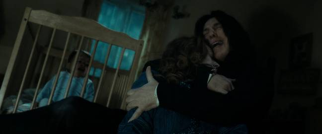 Snape tenderly cradles Lily's body after she is murdered (Credit: Warner Bros)