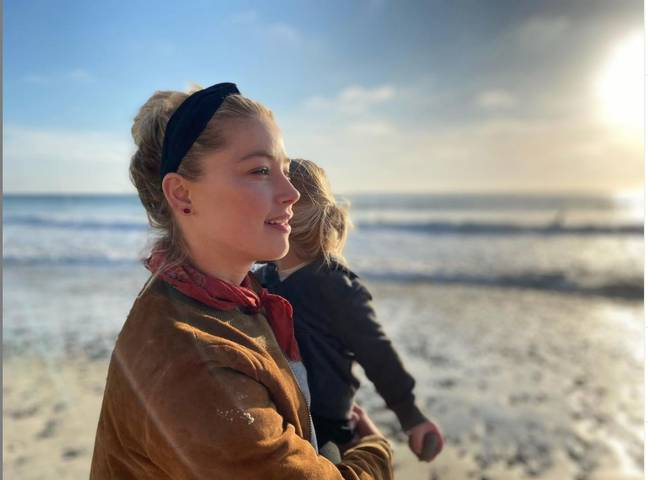 Amber Heard gave a powerful statement on motherhood in her post (Credit: Amber Heard-Instagram)