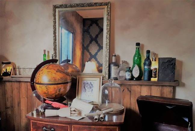 The space is filled with magical details like scroll, quill pens, battered suitcases and wooden globes (Credit: The Steel Cauldron)