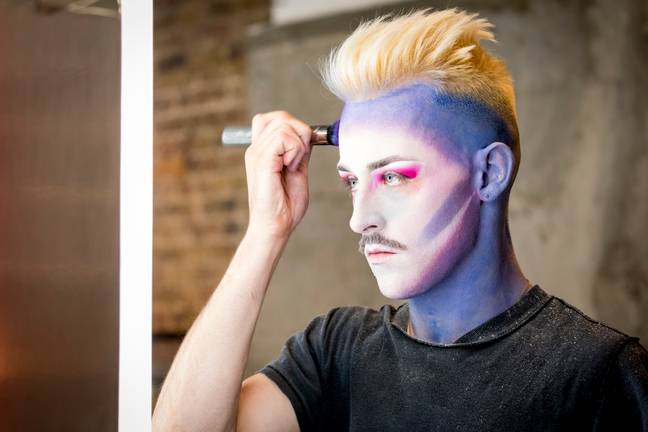 Week one sees the contestants paint their own faces in a task based on identity (Credit: BBC)