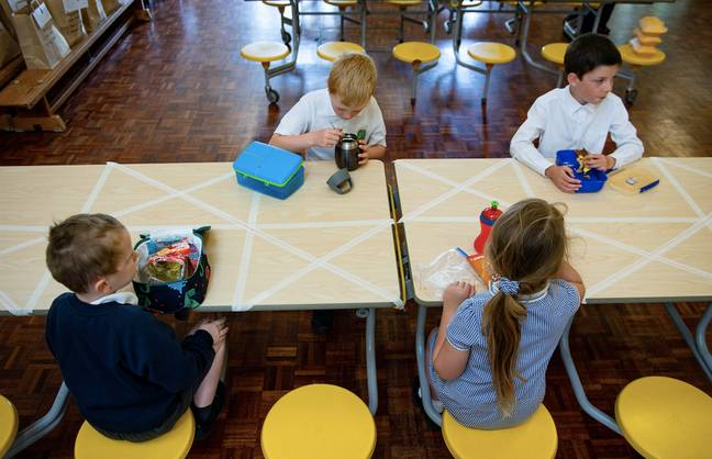 A school in Worcester having a socially distanced lunch (Credit: PA)