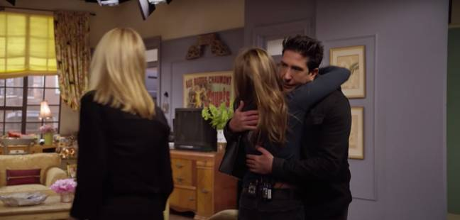 Jennifer Aniston and David Schwimmer hug during the cast's emotional reunion (Credit: HBO Max)