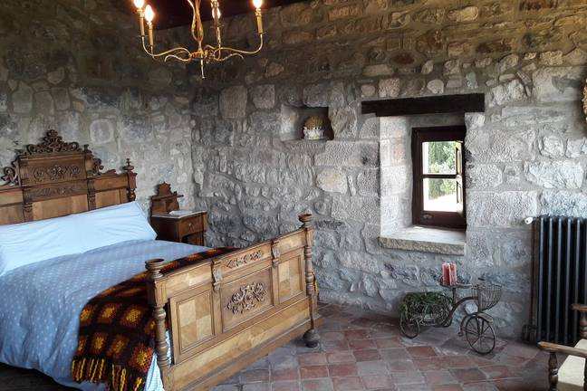 One of the bedrooms in castle Llaés (Credit: Airbnb)